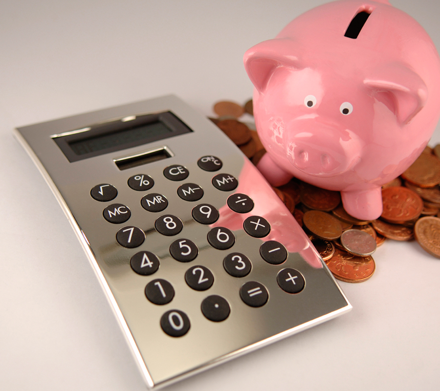 piggy bank with calculator and money pile