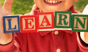 Learning blocks spelling the word LEARN